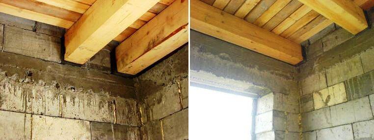 деревянные балки перекрытия в стене дома из теплоблоков