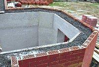 Дом, стена монолитная из крупнопористого керамзитобетона в несъемной опалубке из кирпича и ЦСП по деревянному каркасу